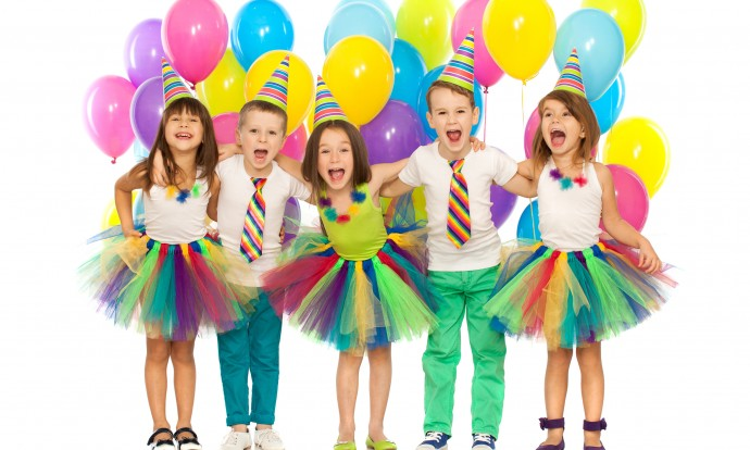 Group of joyful little kids having fun at birthday party. Isolated on white background. Holidays, birthday concept.